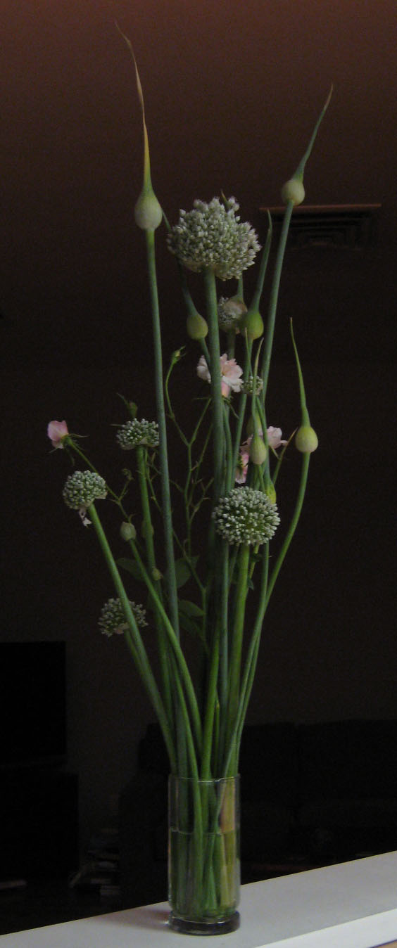 Leeks, onions & roses in a cut flower arrangement